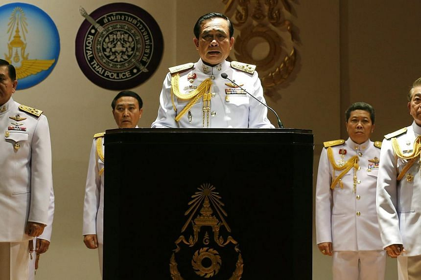 Thai army chief and junta head General Prayuth Chan-ocha (centre) speaks to journalists during a news conference at the Royal Thai Army headquarters in Bangkok, Thailand, on May 26, 2014. -- PHOTO: EPA