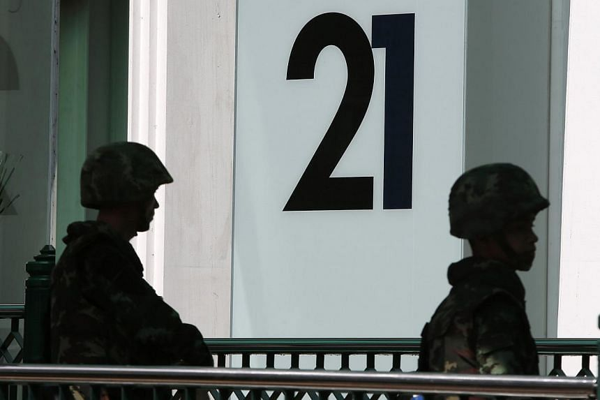 Soldiers stand guard at an elevated walkway at a shopping district in central Bangkok on May 25, 2014. -- PHOTO: REUTERS
