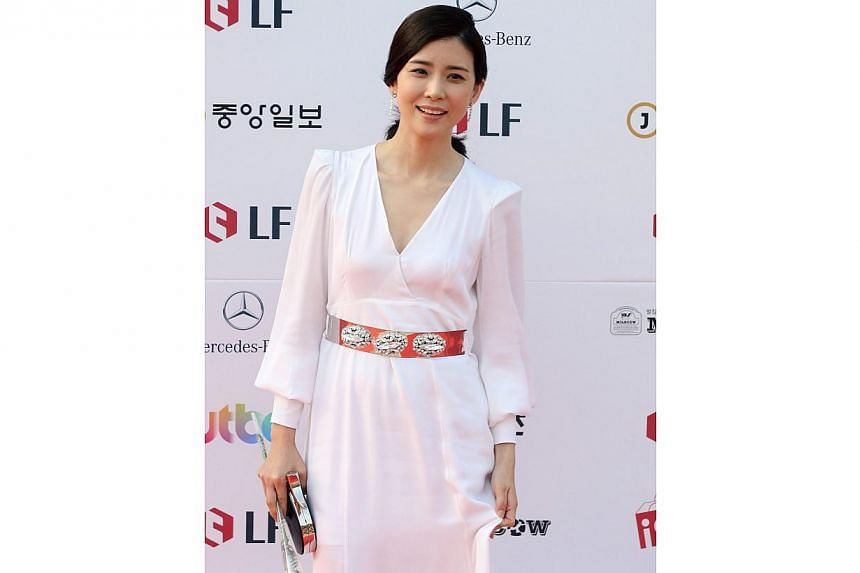South Korean actress Lee Bo Young arrives for the 50th annual Baeksang Art Awards at the Kyunghee University in Seoul, South Korea, on May 27, 2014. -- PHOTO: EPA