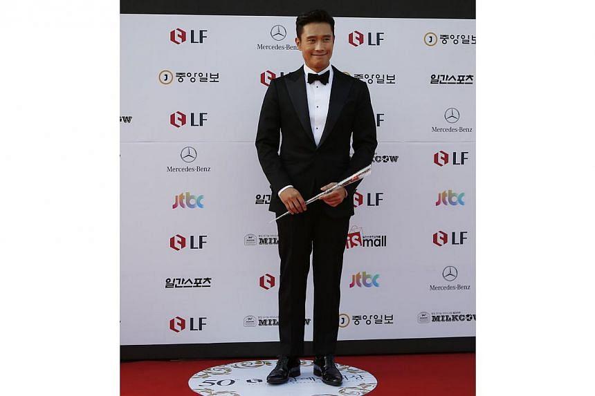 South Korean actor Lee Byung Hun poses before the 50th Baeksang Arts Awards in Seoul on May 27, 2014. -- PHOTO: REUTERS