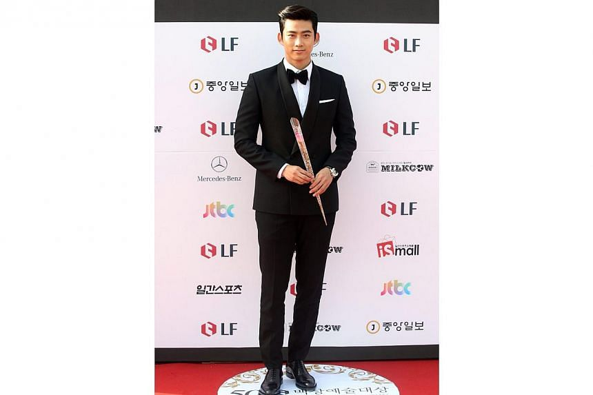 South Korean dance group 2PM member, singer and actor Ok Taecyeon arrives for the 50th annual Baeksang Art Awards at the Kyunghee University in Seoul, South Korea, on May 27, 2014. -- PHOTO: EPA