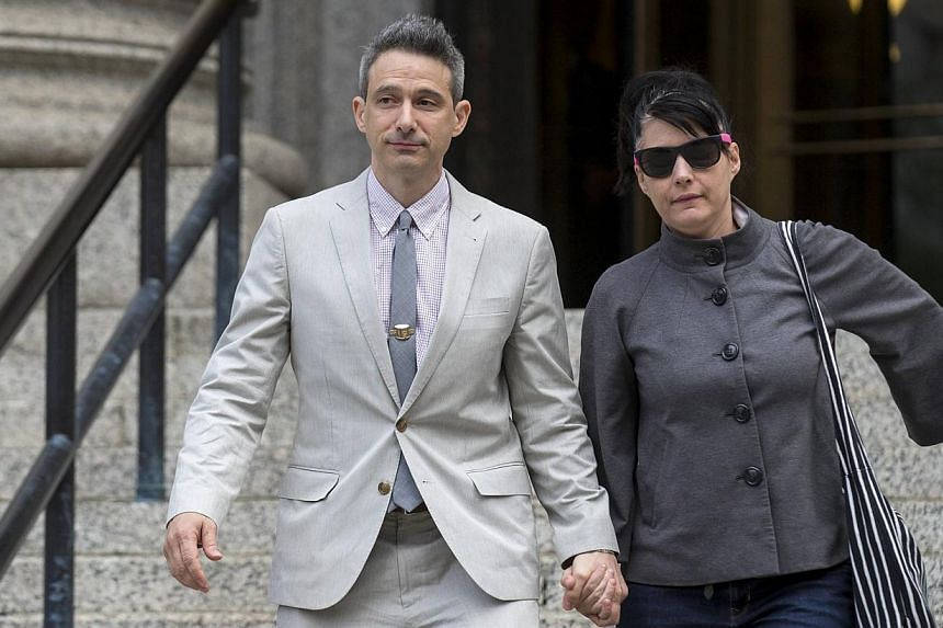 Beastie Boys member Adam Horovitz, also known as Ad-Rock, exits the U.S. District Court for the Southern District of New York in Lower Manhattan with his wife punk singer Kathleen Hanna on May 27, 2014. -- PHOTO: REUTERS