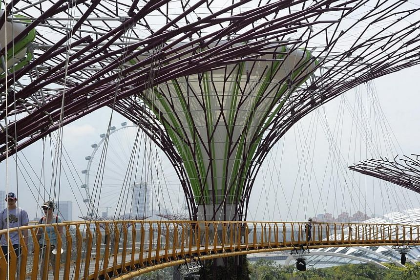 Extensions to Gardens by the Bay and the new Science Centre will be delayed in favour of more urgent projects such as HDB flats, so as to spread out foreign worker demand, Prime Minister Lee Hsien Loong said in Parliament on Wednesday, May 28, 2014.
