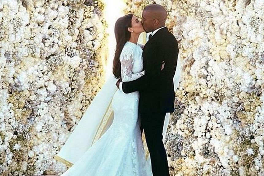 Kim Kardashian has finally revealed the dress she wore at her wedding with rapper Kanye West. -- PHOTO: KIM KARDASHIAN/INSTAGRAM