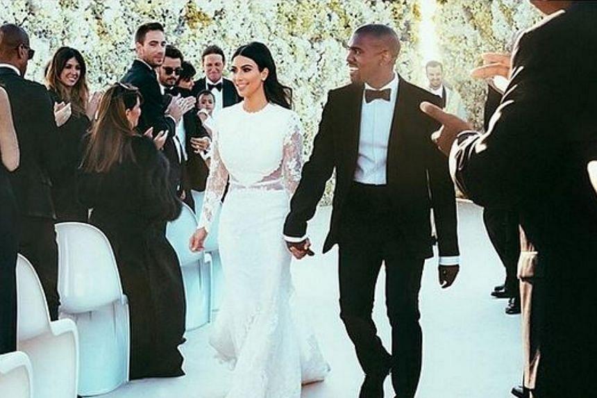 Kim Kardashian has finally revealed the dress she wore at her wedding with rapper Kanye West. -- PHOTO: KIM KARDASHIAN/INSTAGRAM