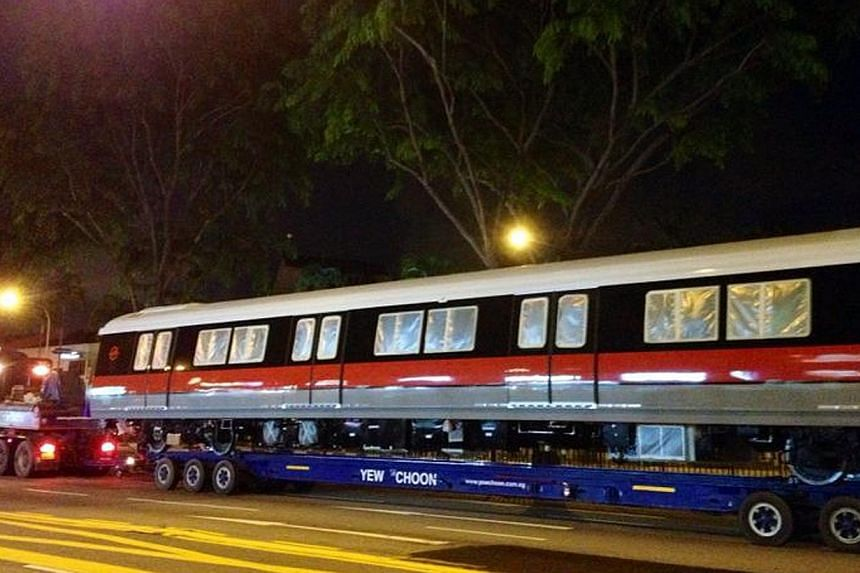 A new MRT carriage being transported along Upper Thomson Road on May 3, 2014. The Land Transport Authority has spent $749 million to buy 91 four-car trains for the upcoming Thomson and Eastern Region Lines. -- ST PHOTO: ARTI MULCHAND