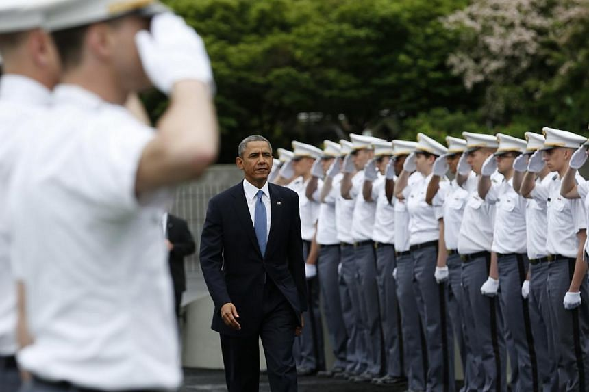 """US President Barack Obama arrives for the commencement ceremony at the United States Military Academy at West Point, New York on May 28, 2014.Mr Obama warned Wednesday, May 28, 2014, that the United States was ready to respond to China's """"aggre"""