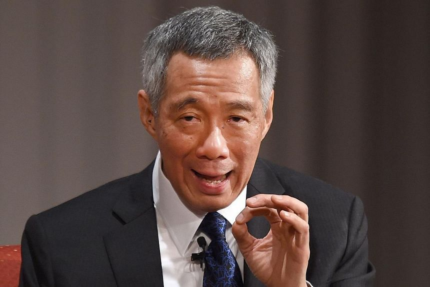 Singapore Prime Minister Lee Hsien Loong answers questions during the 20th International Conference on the Future of Asia in Tokyo on May 22, 2014. It is very important for Singapore to get its politics right because constructive politics will h