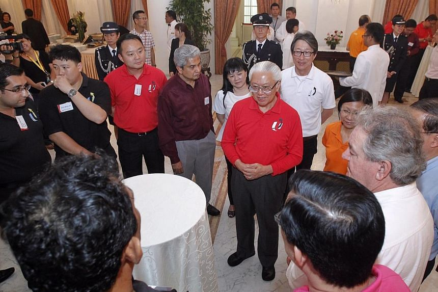 President Tony Tan Keng Yam hosted more than 70 union leaders from the industrial, services and public sectors to tea at the Istana on Wednesday, May 28, 2014. -- ST PHOTO:KEVIN LIM