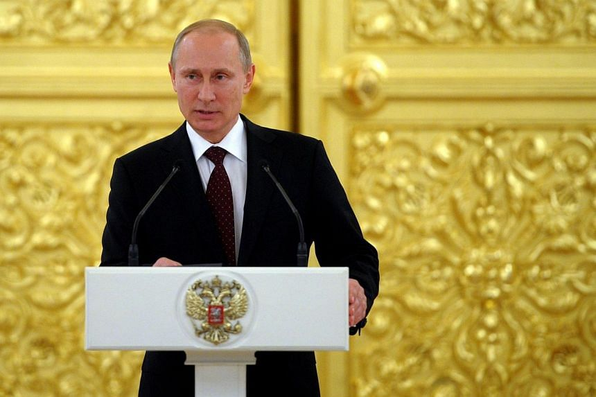Russia's President Vladimir Putin speaks at the Kremlin in Moscow on May 27, 2014. Mr Putin is due to meet his French counterpart Francois Hollande for Ukraine talks on the eve of events marking the D-Day anniversary, a Kremlin aide said Wednesd