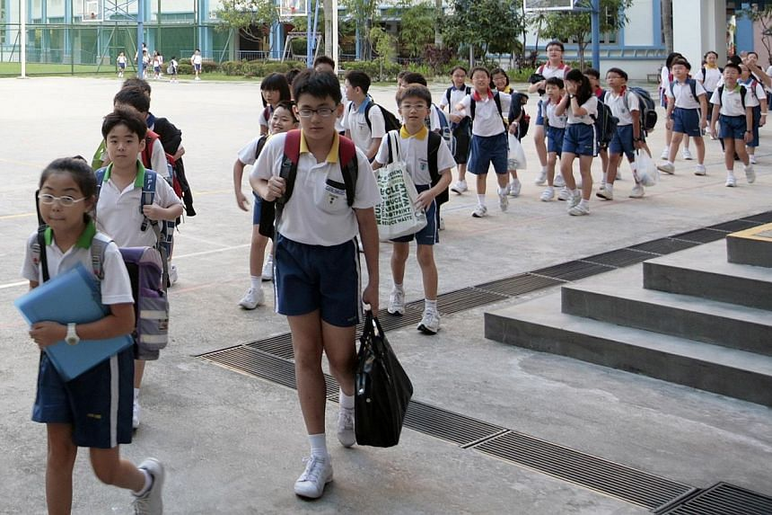 Starting from school to the workplace and society at large, the Government is moving to make sure that pathways remain open for all Singaporeans in every stage of their lives. -- PHOTO: ST FILE