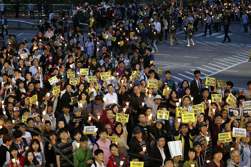 Protesters mourning the tragic sinking of the Sewol passenger ferry marching through the streets of downtown Seoul, South Korea on May 24, 2014.The daughter of a fugitive Korean tycoon accused of being responsible for last month's ferry disaste
