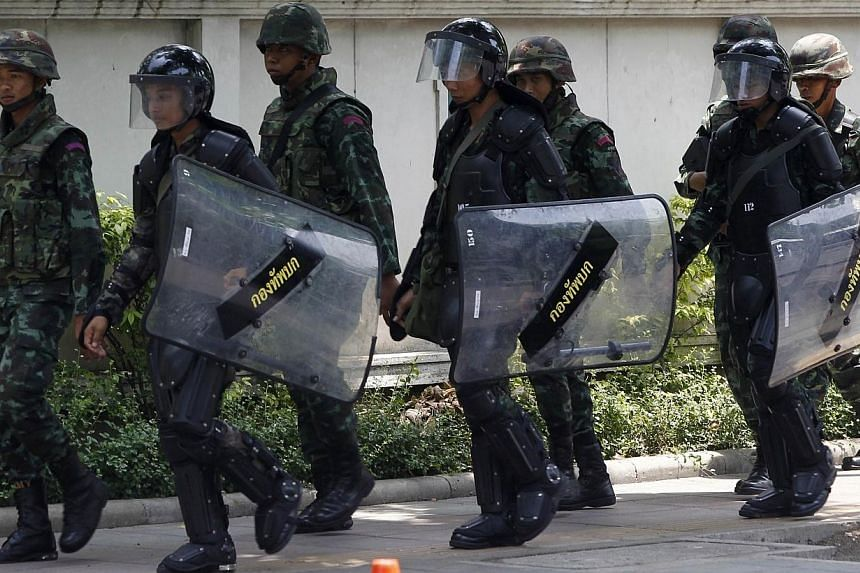 Thai soldiers patrol around the Army Club in Bangkok on May 28, 2014. Thailand's information technology ministry blocked Facebook on Wednesday, May 28, 2014, and planned to hold talks with other social networking sites to stem protests against t