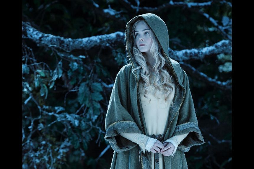 Actress Elle Fanning grew up identifying with the character of Sleeping Beauty, a role she plays in the movie Maleficent (above). -- PHOTO: WALT DISNEY STUDIOS MOTION PICTURES, SINGAPORE
