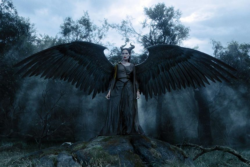 Angelina Jolie plays Maleficent (above), who curses Aurora to prick her finger and fall into a deep sleep. -- PHOTO: WALT DISNEY STUDIOS MOTION PICTURES, SINGAPORE