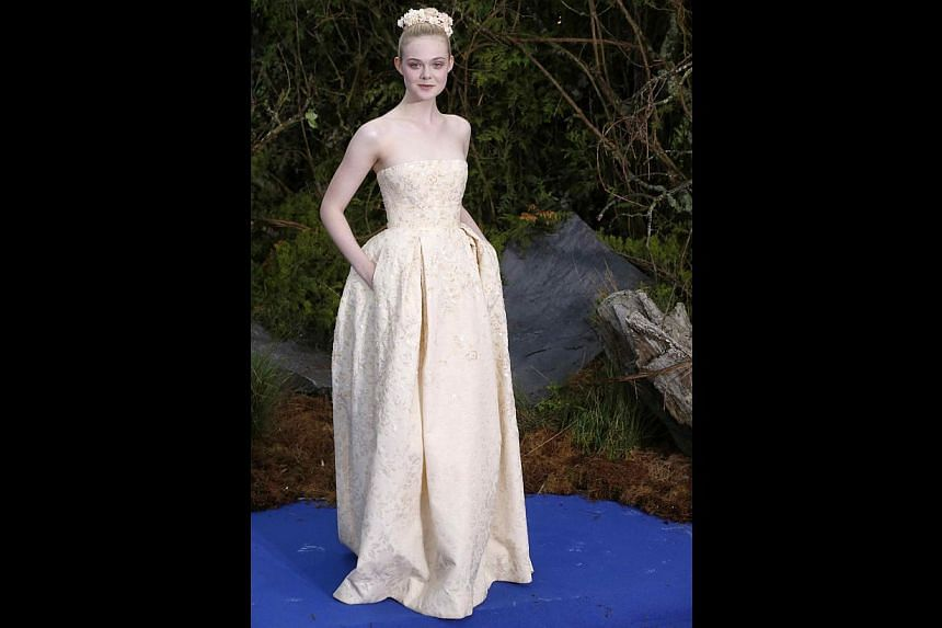 Actress Elle Fanning (above) grew up identifying with the character of Sleeping Beauty, a role she plays in the movie Maleficent. -- PHOTO: REUTERS