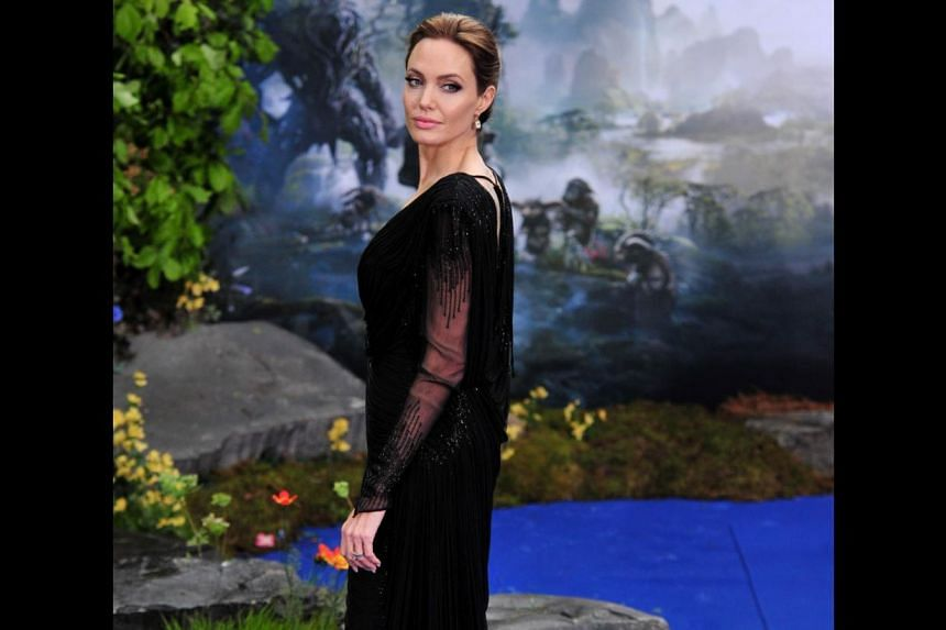 Angelina Jolie (above) plays Maleficent, who curses Aurora to prick her finger and fall into a deep sleep. -- PHOTO: AGENCE FRANCE-PRESSE