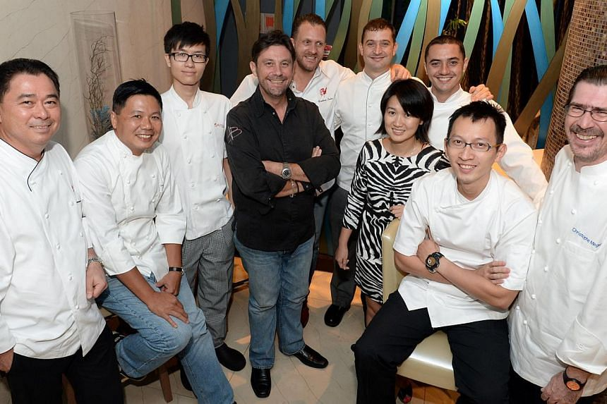 The Bocuse d'Or committee and mentorship panel, which includes Mr Christophe Megel (above, right), president of Bocuse d'Or Singapore, chef Yew Eng Tong (above, second from right), who will be taking part in the competition, and other big-name ch