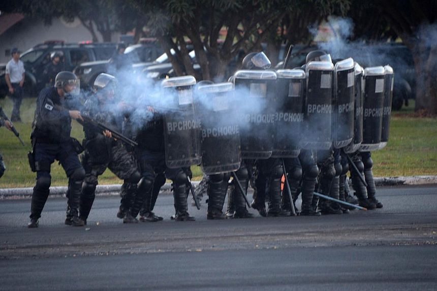 Riot policemen confront protesters during clashes following a protest against the upcoming FIFA World Cup in Brasilia on May 27, 2014. -- PHOTO: AFP