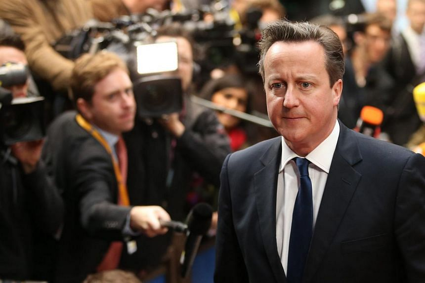British Prime Minister David Cameron arrives at the informal dinner for heads of states and government of the EU at the Council headquarters in Brussels, Belgium on May 27, 2014. -- PHOTO: EPA
