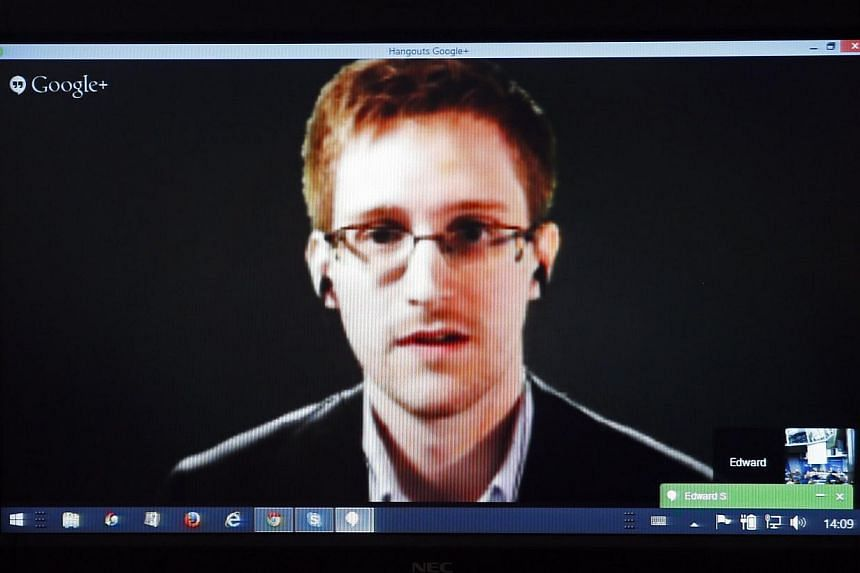 Accused United States government whistle-blower Edward Snowden is seen on a screen as he speaks via video conference with members of the Committee on Legal Affairs and Human Rights of the Council of Europe's Parliamentary Assembly during a hearing on