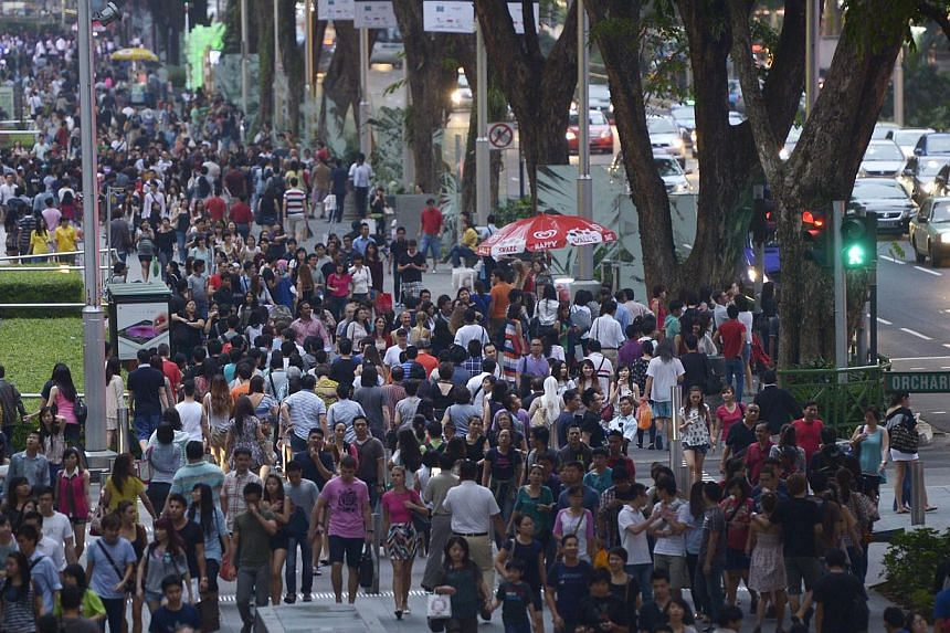 """The crowd along Orchard Road on Jan 2, 2014. Twelve civil society groups and 20 other people, including well-known activists Constance Singam and Vincent Wijeysingha, have signed a statement to raise concerns about """"the recent surge of racism and xen"""