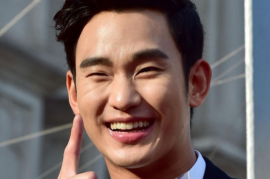 South Korean actor Kim Soo Hyun poses for a photo call on the red carpet of the 50th annual BaekSang Art Awards in Seoul on May 27, 2014. -- PHOTO: AFP