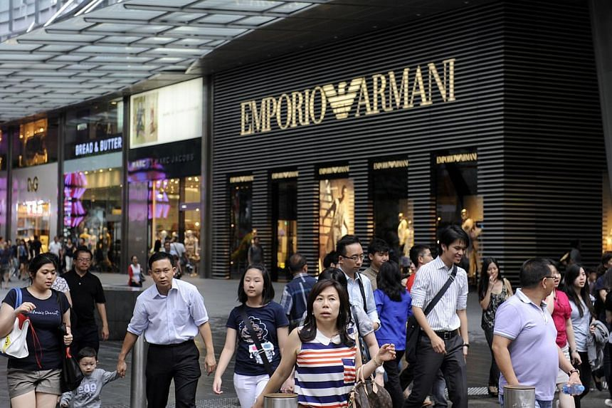 Shoppers in front of Mandarin Gallery along Orchard Road on Jan 9, 2012. Rents for prime shops in Orchard Road remained firm in the first quarter this year but they could soften in the near future, property consultancy Savills said in a report. -- PH
