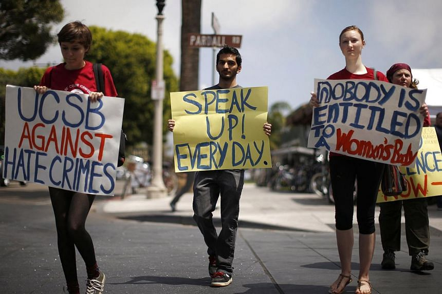 University of California, Santa Barbara (UCSB) students march between drive-by shooting crime scenes in a protest against sexual violence and hate crimes. -- PHOTO: REUTERS