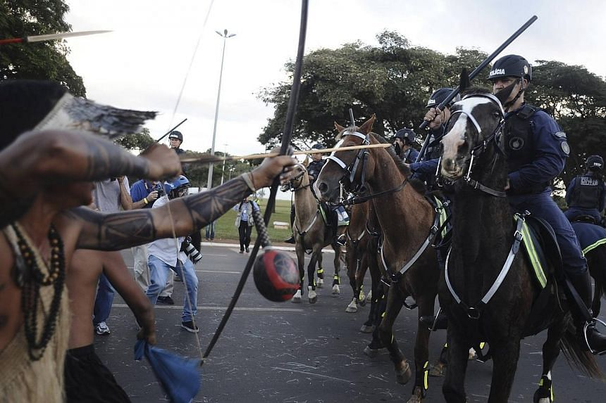 Police confront native Brazilians to impede them from marching towards the Mane Garrincha football stadium during a demonstration in Brasilia, May 27, 2014. -- PHOTO: REUTERS