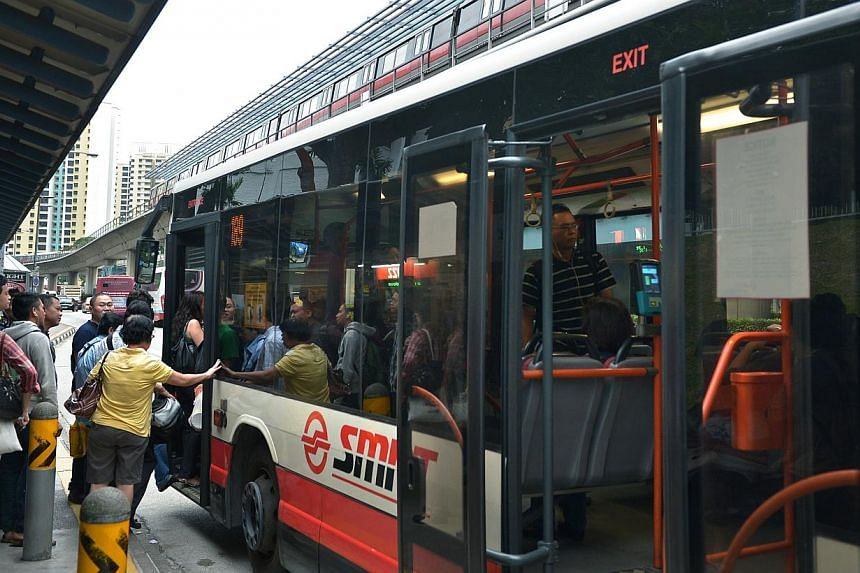 Commuters boarding a bus at the bus stop next to Clementi MRT along Clementi West Avenue on Jan 17, 2014.The first bus service package to be tendered out under a new operating model will comprise 24 existing routes in the western part of the is