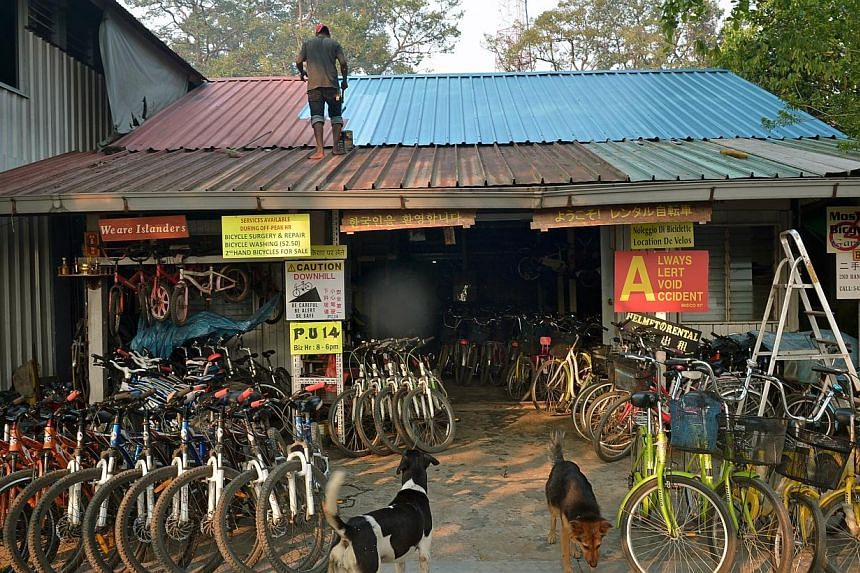 A bicycle shop on Pulau Ubin. The project to redevelop Pulau Ubin is a good opportunity for active citizens to work with the Government, said Minister of State for National Development Desmond Lee on Wednesday as he spoke about how the Government and
