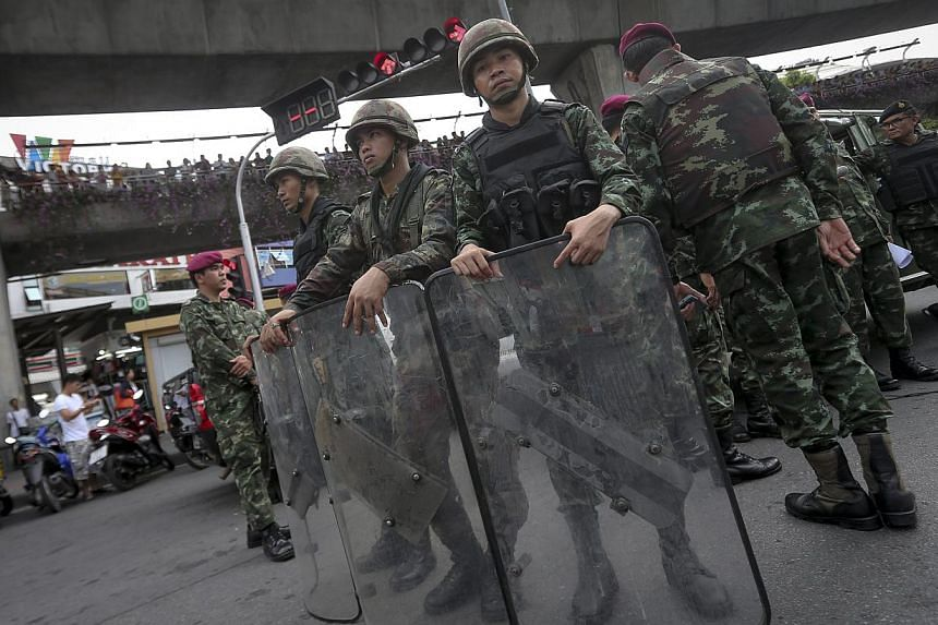 Thai soldiers stand guard during a protest against the military coup at the victory monument in Bangkok, Thailand on May 27, 2014. -- PHOTO: EPA