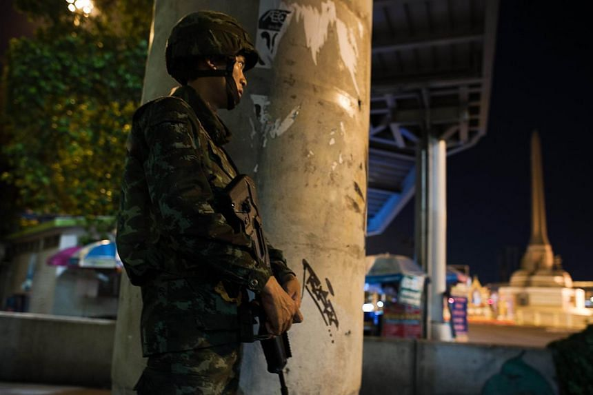 A Thai soldier stands guard during a curfew imposed by the Thai army at Victory monument in Bangkok on May 25, 2014. -- PHOTO: AFP
