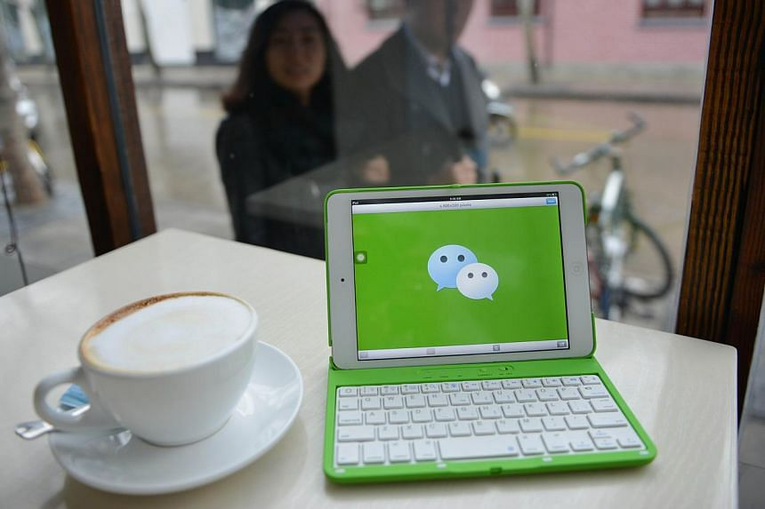 China's ruling Communist Party is launching a new crackdown on popular instant messaging platforms including Tencent's WeChat, state media said on Wednesday, the latest in a series of moves to stifle online speech. -- PHOTO: AFP