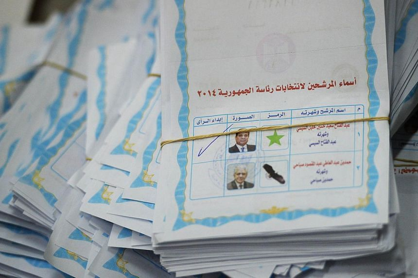 A picture shows an Egyptian presidential election ballot with the ticked choice of candidate and former army chief Abdel Fattah al-Sisi in a polling station in Cairo on May 28, 2014. Egyptian ex-army chief Abdel Fattah al-Sisi on May 28 led with abou