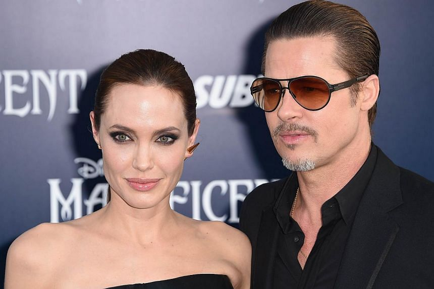 Angelina Jolie and Brad Pitt arrive for the world premiere of Disney's Maleficent at El Capitan Theatre in Hollywood, California. on May 28, 2014. -- PHOTO: AFP