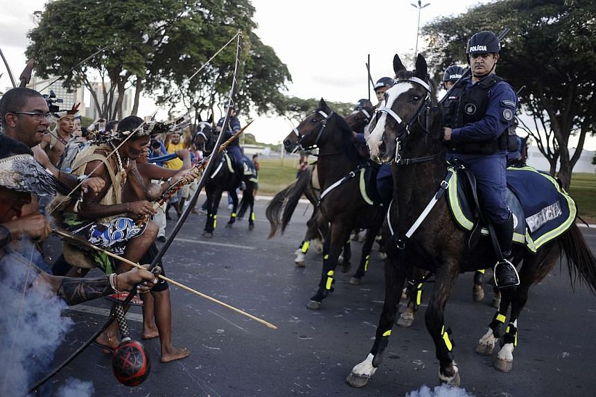 Police use tear gas to impede native Brazilians from marching towards the Mane Garrincha soccer stadium during a demonstration in Brasilia, on May 27, 2014. -- PHOTO: REUTERS