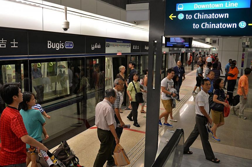 People walk out of the train at Chinatown station along the new Downtown Line 1 on Dec 7, 2013 during a trial run. -- PHOTO: ST FILE