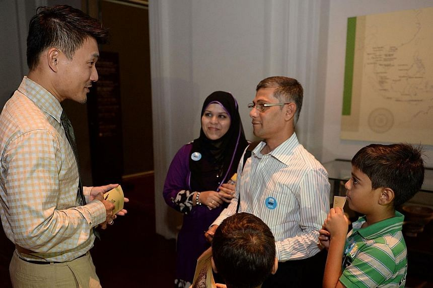 Supply chain manager Mujib Shakir (right), chats with Tampines GRC MP Baey Yam Keng during a citizenship ceremony held at the Asian Civilisations Museum on Sep 1, 2013. The Government can do better in its policymaking so that policies can be mor