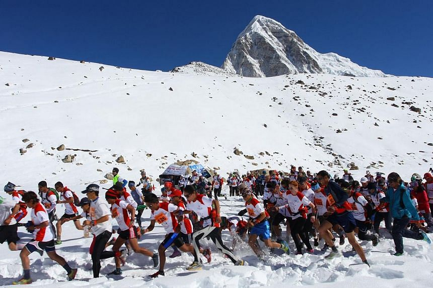 In this photograph received by Himex, the organisers of the Tenzing-Hillary Everest Marathon on May 29, 2014, marathon participants run at the start of the race at Gorapshep near Mount Everest Base camp in Nepal. -- PHOTO: AFP/HIMEX