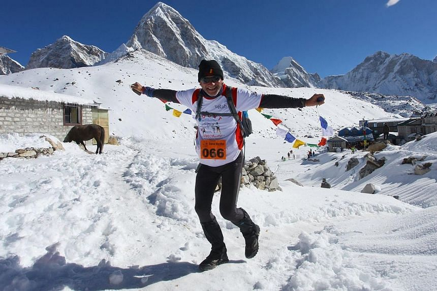 In this photograph received by Himex, the organisers of the Tenzing-Hillary Everest Marathon on May 29, 2014, marathon participant Francis Kersten of Belgium gestures as he runs near the start of the race at Gorapshep near Mount Everest Base camp in