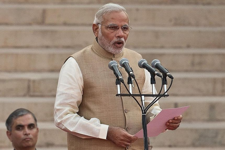 Narendra Modi takes the oath of office as India's new Prime Minister in New Delhion May 26, 2014.Indian Prime Minister Narendra Modi invited Chinese President Xi Jinping on Thursday, May 29, 2014, to visit, seeking greater engagement betw