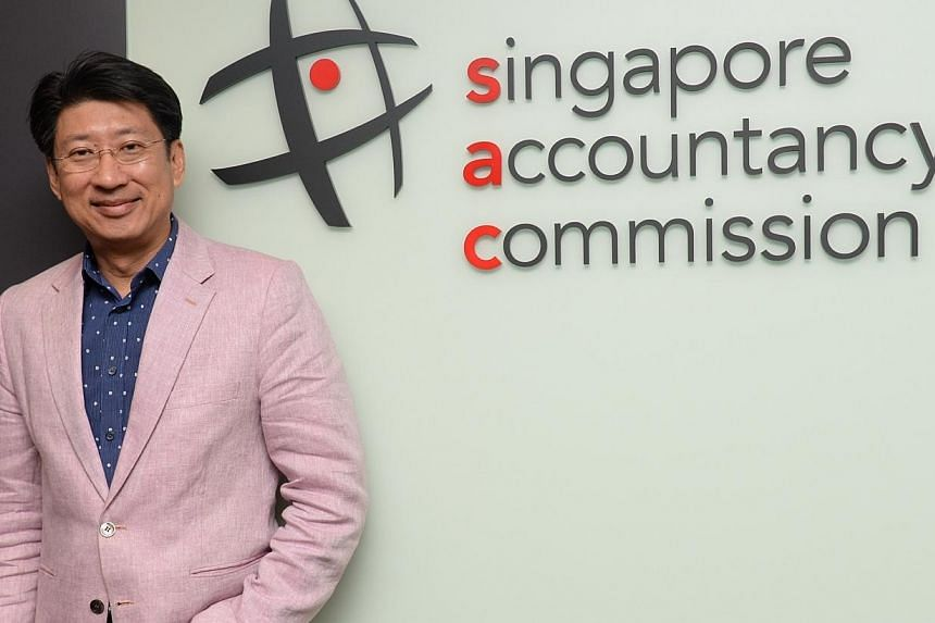 One on one interview with Mr Uantchern Loh, chief executive of the Singapore Accountancy Commission (SAC). If Mr Uantchern Loh had his way, first-year accountants would be earning at least $4,000 monthly. -- ST PHOTO: AZIZ HUSSIN