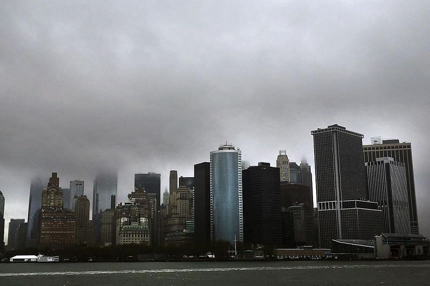 The Financial District in Manhattan is viewed from New York Harbor on April 30, 2014 in New York City. The US economy contracted at an annual rate of 1.0 per cent in the first three months of 2014, a significantly weaker performance than initial