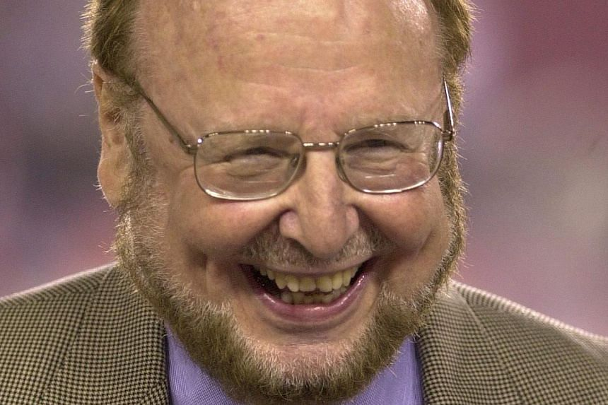 A file photograph dated Oct 6, 2003 shows Malcom Glazer smiling before an NFL American Football game between the Tampa Bay Buccaneers and the Indianapolis Colts, at Raymond James Stadium in Tampa, Florida, USA. Manchester United fans on Wednesday pai