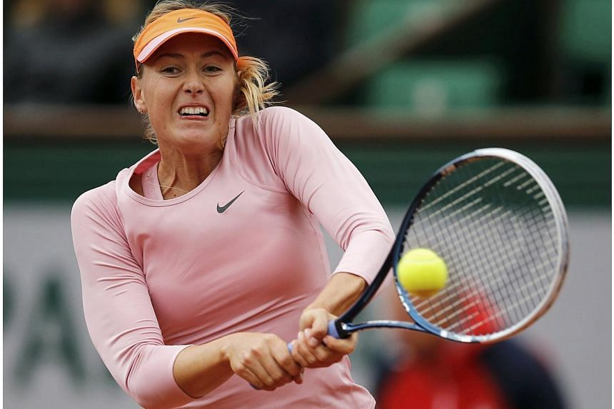 Maria Sharapova of Russia returns a backhand to Tsvetana Pironkova of Bulgaria during their women's singles match at the French Open tennis tournament at the Roland Garros stadium in Paris on May 28, 2014. -- PHOTO: REUTERS