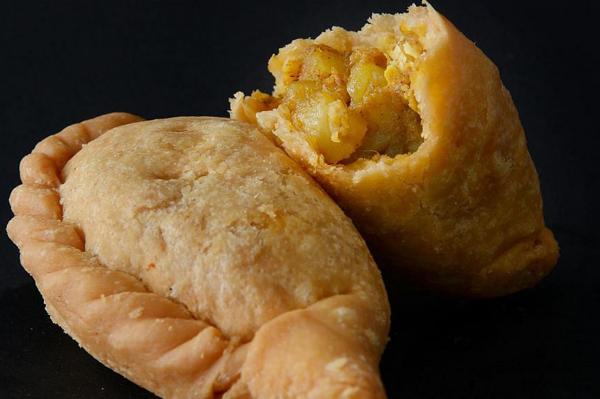 Curry puffs from Old Chang Kee. -- PHOTO: THE NEW PAPER FILE