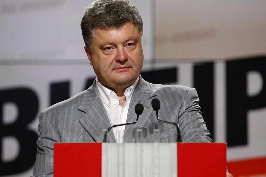 Ukrainian businessman, politician and presidential candidate Petro Poroshenko attends a news conference in Kiev on May 26, 2014. -- PHOTO: REUTERS