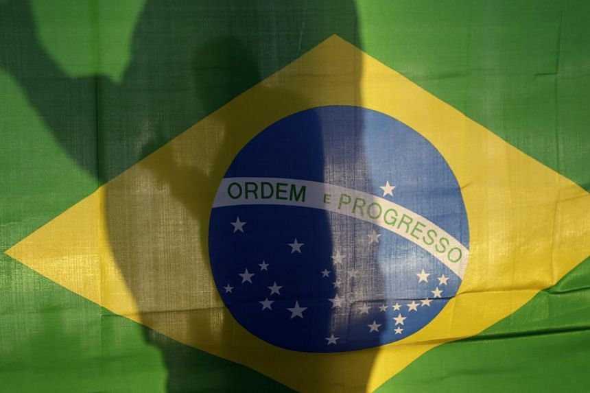 The world should judge Brazil on how well it hosts the World Cup and not assume recent protests and strikes will derail the event, a government minister said on Wednesday, May 28, 2014. -- PHOTO: REUTERS
